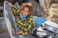 Bedouin girl doing the dishes