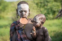 Mursi tribe:   See more in the book: http://www.blurb.com/b/4633120-people-of-the-omo-valley-under-climate-and-other-p