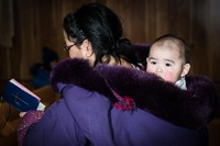 Inuit mother and child; Kangiqsualujjuaq, Canada