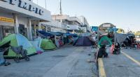 Refugees camping in Athens airport in Greece.