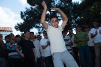 Syrian refugee dance in the makeshift camp in the square next to the train station in Belgrade, Serbia.
