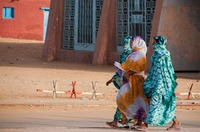 Women strolling in a desert village