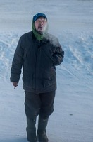 Inuit man an early morning in Kuujjuaq, Canada