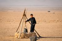 A Syrian boy fetching water in a well during a climate induced drought in The Northeast Syria.