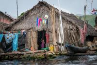 In Panama, the Kuna Yala peoples are already experiencing the impacts of the raising sea level due to climate change . Their and homes are often flooded.