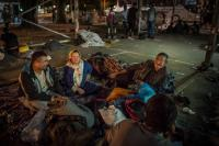 Late evening, in a parking lot  Afghani refugees in a parking lot where they will spend the night in Belgrade, Serbia.