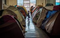 many 100s of refugees camping in the old Athens airport in the old departure terminal in Greece
