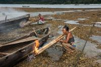 Moken Women are Sealing Their Boats, Myanmar