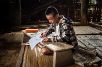Naga Youth Doing His Homework, Myanmar